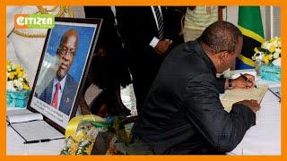 President Kenyatta signs condolence book for the late President John Magufuli at Tanzanian Embassy