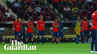 Players protest unpaid wages by standing still in Mexican football match