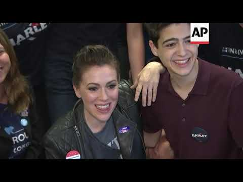 Alyssa Milano greets activists at Democratic campaign office on Election Day