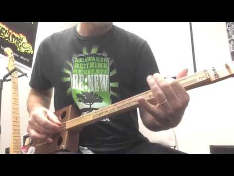 The Edge - 3 String Cigar Box Guitar w Yardstick Fingerboard