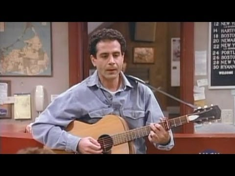 Tony Shalhoub plays guitar and sings in Wings