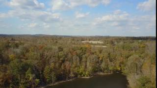 Free 4K Aerial Stock Footage of lake trees and farmland