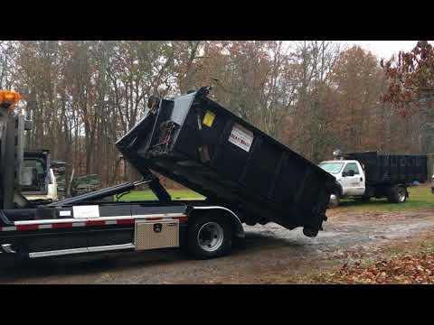 Bering Lifting Heavy Dumpster