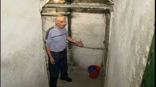 Peter Fischl, 63 years later, returns to 1 of the places he hid to survive the Holocaust in Hungary