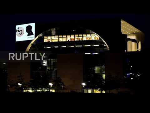 Germany: Greenpeace activists critique 'Diesel Summit' meeting with projection on German Chancellery
