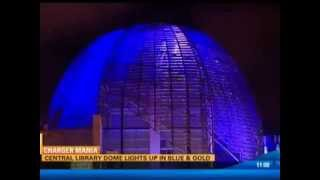 KFMB TV -- Central Library lit up with Charger blue and gold