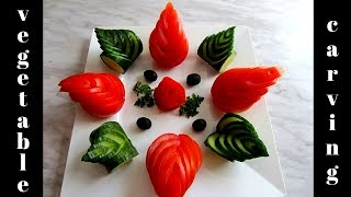 Tomato and cucumber art veggie carving. Vegetable carving garnish