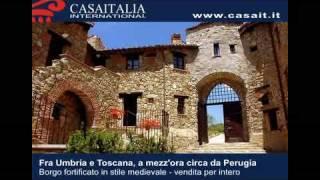 Castelli vendita - Borgo fortificato in stile medievale in vendita fra Umbria e Toscana