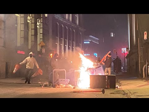 Rioters set fires, smash windows in Montreal curfew protest