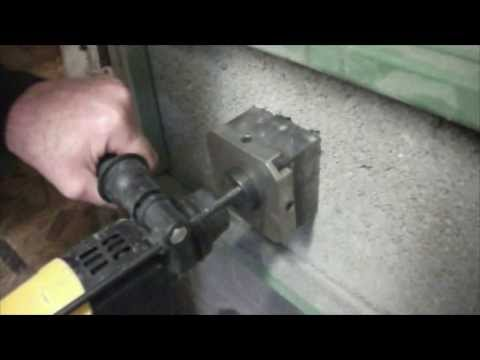Drilling a square hole using a Quadcut Square Hole Cutter - cordless Dewalt drill