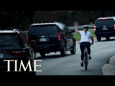 Woman Fired Over Photo Flipping Off President Trump's Motorcade Files Suit | TIME