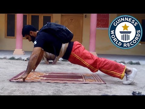 Two finger push ups carrying a 40 pound pack - Guinness World Records
