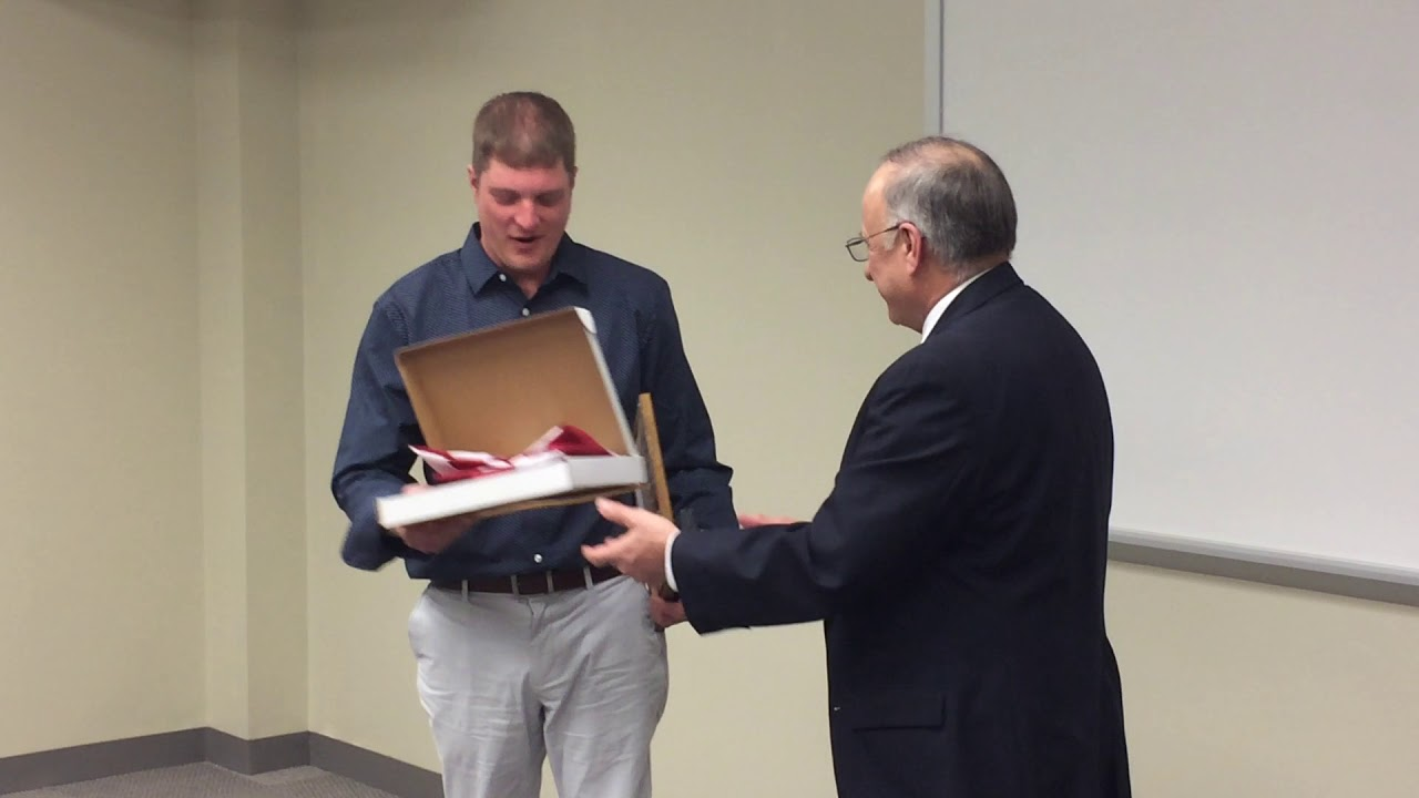 Rep. Steve King presents medals to U.S. Army Sgt. Adam Menin, Sioux City