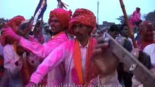 Celebrating holi with gaiety in song and dance, India
