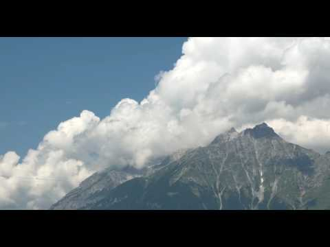 1 HOUR CLOUDS ABOVE MOUNTAUNS 4K VIDEO AMBIENT SLOW TV RELAXATION