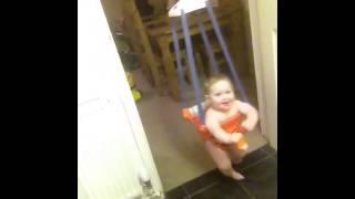 Baby swinging in door bouncer
