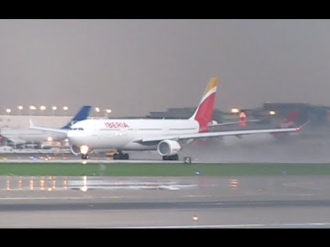 Iberia New Livery A333 Takeoff at Chicago O'Hare During a Storm