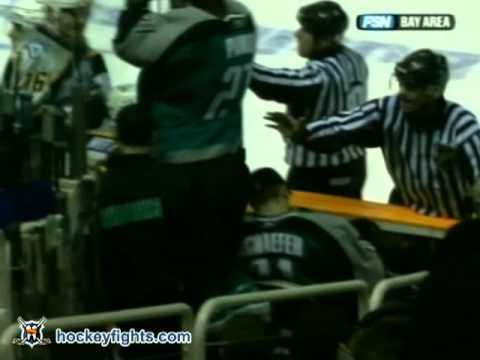 Scott Parker tries to climb the boards to fight Brendan Witt Mar 11, 2006