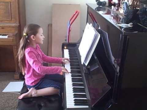Abby playing and singing Tingalayo