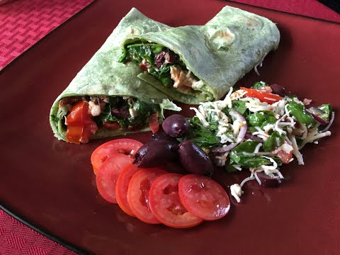 Mediterranean chicken with assortment of veggies rolled up in a spinach wrap