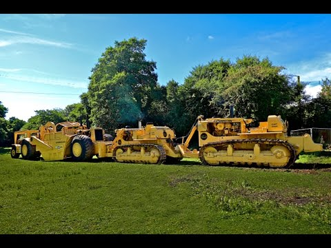 Caterpillar double D9 bulldozer (DD9/Quad-Trac) meets Cat motor scraper, 1750 horsepower combination
