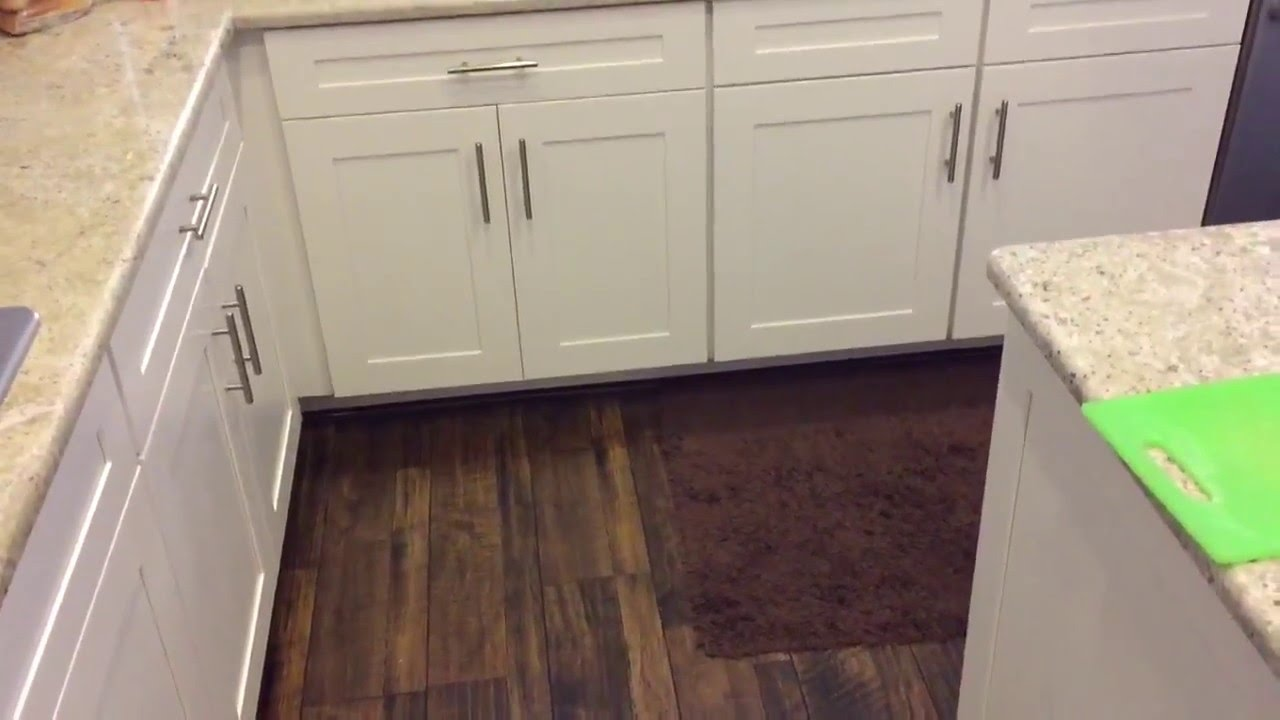 FLOATING KITCHEN FLOORING INSTALLATION LAMINATE WOOD FLOORING - YouTube