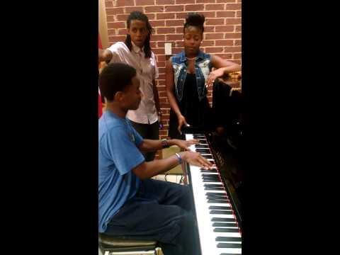 A'Mya Jones singing with Amari Moyo