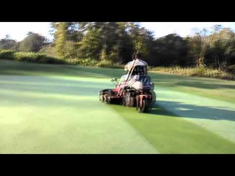 Golf course greens and grounds: Mowing Greens with Toro