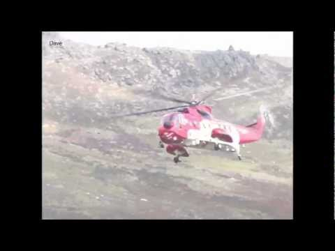 Irish Coast Guard Rescue Helicopter Sikorsky S61 lands on comeragh mountains