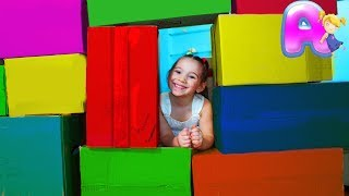 Hide- and- seek with Anna builds a big house from big boxes