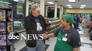 Cashier reunites with man who left $273M lotto ticket
