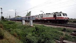 INDIAN SEMI BULLET TRAIN WITH WAP-5 NAVKIRTI RUSHES PAST AT 160 KMPH OVERTAKING PUNE DURONTO EXPRESS