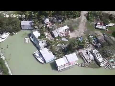 Aerial footage shows toppled buildings and damaged boats in Key Largo, Florida after it was struck b