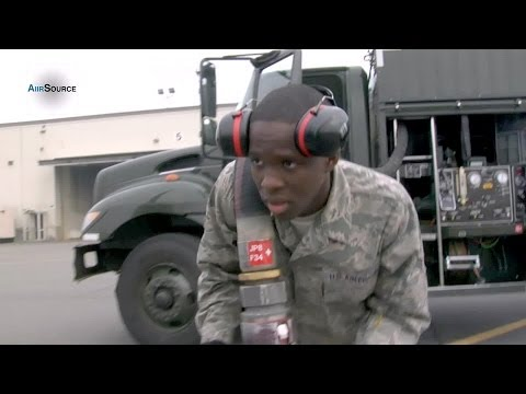 Jet Fuels: Refueling Operator Pumping up the Flight Line - S