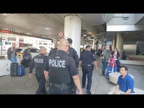 Lax airport police and undercover cops arrest unofficial skycap at lax