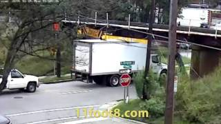 Another reefer truck stuck under the 11foot8 bridge