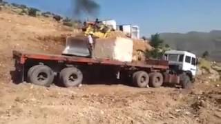 Removing a block of stone off a truck