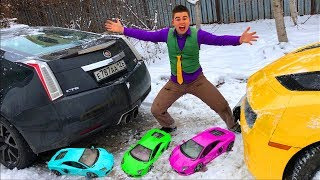 Mr. Joe on Chevy Camaro VS Cadillac CTS-V in Snow Race & found A LOT OF Toy Car in Trunk for Kids
