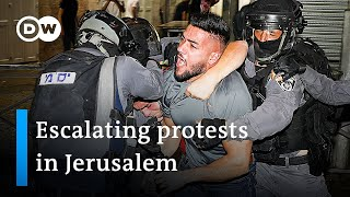 Hundreds injured in clashes at Jerusalem's Al-Aqsa mosque | DW News