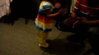 priscilla in dhaka dancing with her father akbar with  the song putul putul .MPG