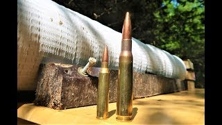 338 Lapua magnum VS 50 BMG - HOW MANY PAPER PLATES???