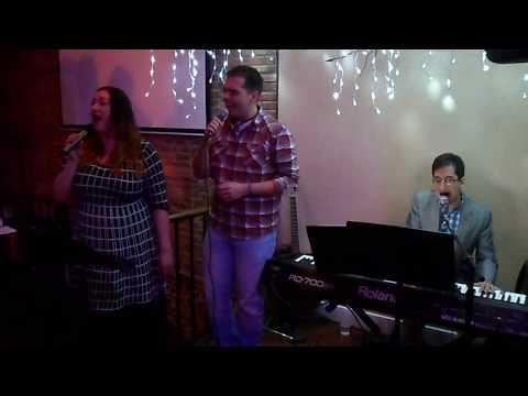 Jonathan Tuzman, Brad Emmett, and Jenny Lynn Towns sing