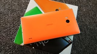 Распаковка Nokia Lumia 930 в оранжевом цвете (unboxing)