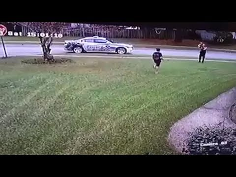 Cops Pulls Over To Have Catch With Boy Playing Football Alone