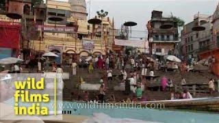 Varanasi Ganga ghat : temple bells tolling, conch shells sounding at evening arati