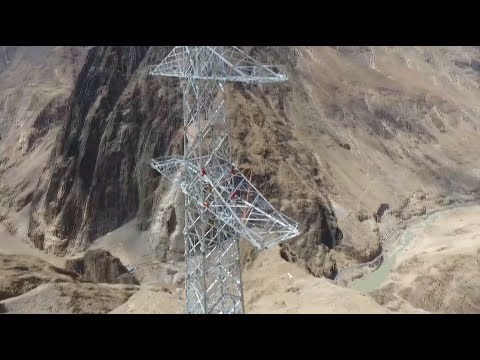 Chinese Workers Take Pride in Building Power Towers on Cliffs in Tibet