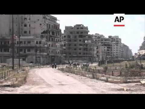 Syria - Residents return to badly damaged city of Homs after rebels are evacuated / Syria's Assad wi