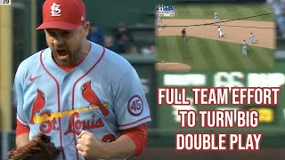 Cardinals turn a wild inning-ending double-play, a breakdown