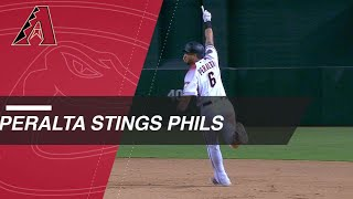 Peralta leads D-backs to win in the 14th