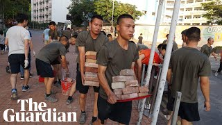 Hong Kong: China deploys troops to help clear roadblocks at university